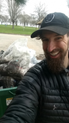 Brian Differding smiling over a pile of trash